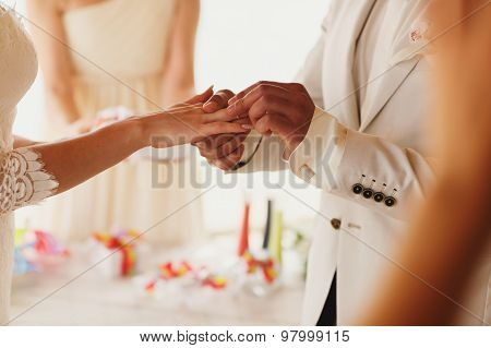 Beautiful  Gorgeous Blonde Bride With Orchids And Stylish Groom Putting On Rings, Hawaii