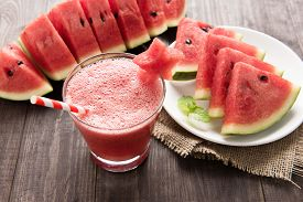 picture of star shape  - Healthy watermelon smoothie with of watermelon in star shape on a wood background - JPG