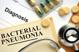 picture of pneumonia  - Word Bacterial pneumonia on a paper and pills on the wooden table - JPG