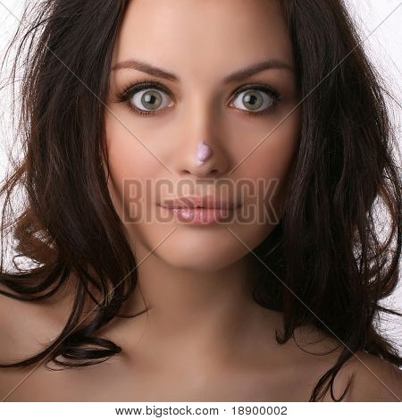 young attractive woman with silly face on white background