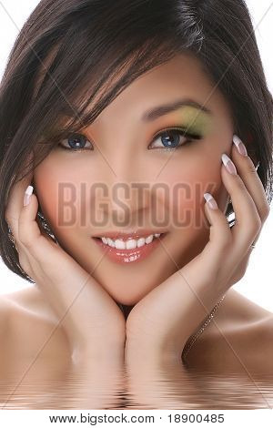 attractive asian woman with white teeth looking at camera isolated on white