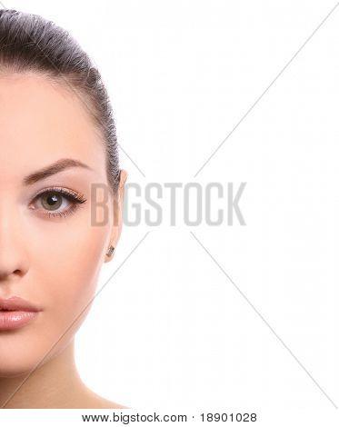 half of female face isolated on white background