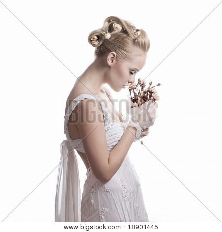 pretty young bride with flowers isolated on white background