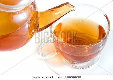 Pouring tea to a teacup