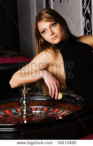 Young woman near roulette in casino