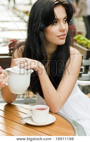 Beautiful woman drinking tea in a cafe