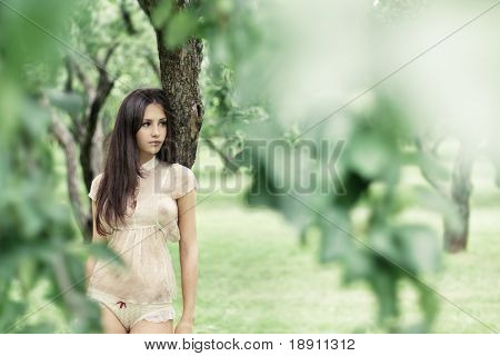 beautiful girl in a wild garden