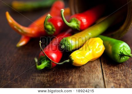 Colorful peppers on rustic kitchen table