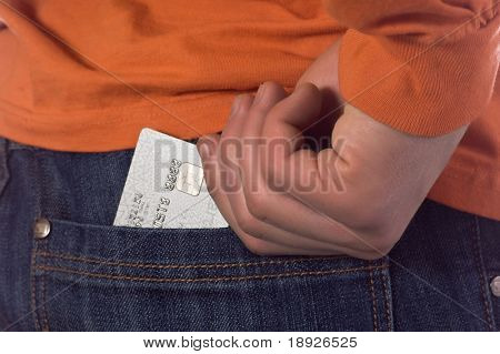 Credit card in the back pocket of blue jeans