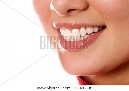 smiling young girl mouth with great teeth (isolated on white)
