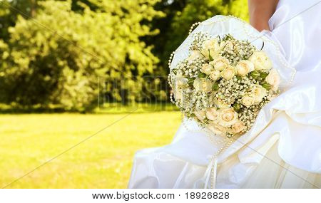 bride with bridal bouquet(focus on the flowers)
