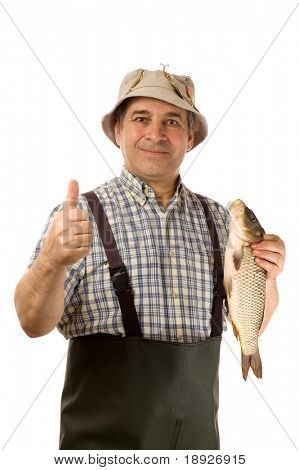 Senior fisherman with his catch, thumb up. (isolated on white)