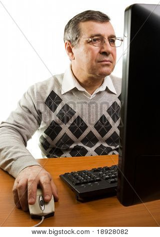 Senior man with computer (isolated on white)