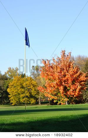 Golf Flagstick With Colorful Fall Leaves