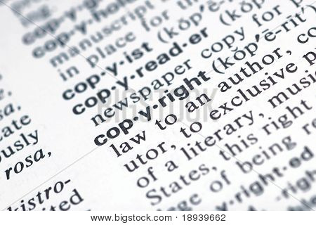 The word copyright from the dictionary showing a shallow depth of field