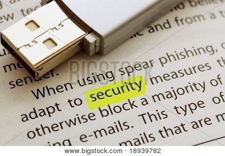 USB flash drive next to the word security