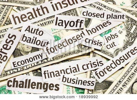 News headlines and money representing an economy in recession