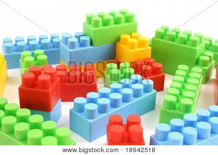 colorful plastic toy bricks close up in studio
