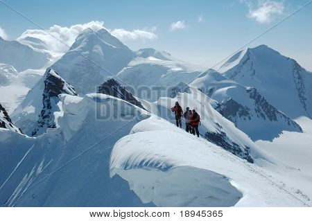 Climbers, on background the peaks and glaciers of Monte Rosa massif, west Alps, Europe