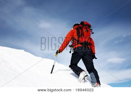 Climber on a snowy ridge; horizontal frame. Italian alps.