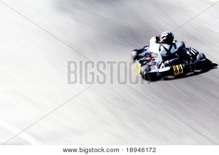 Panning shot of a go-kart racer. Horizontal orientation.