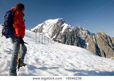 Male young climber standing in front of south side of Mont Blanc; Italy - France