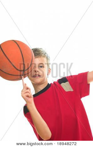 Boy playing basketball. Isolated on white