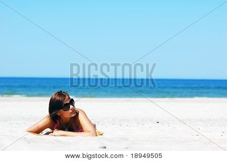 Beautiful woman relaxing on the beach
