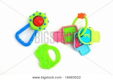 Colorful rattle for baby on white background