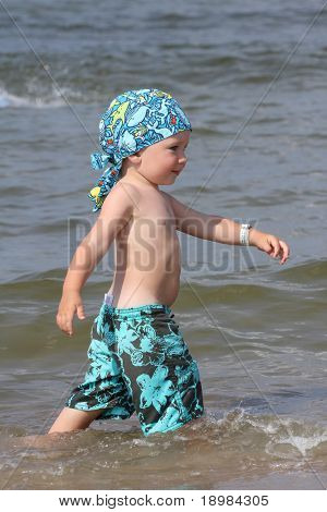 Child, water and fun. Baby boy have fun. Two years old baby boy on the beach.