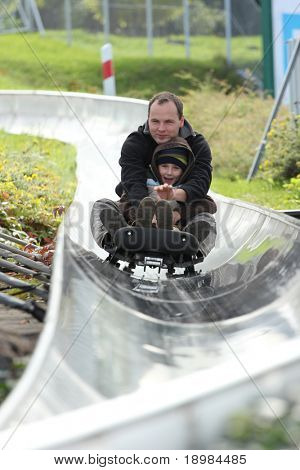 Father with boy on the bobsled run