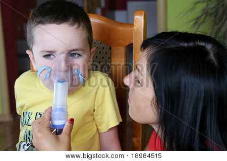 Mother and 5 years old child taking respiratory, inhalation therapy.