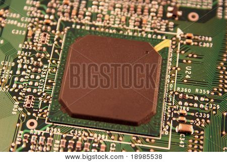 A close up of a computer motherboard chip.
