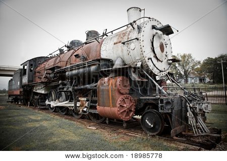 an old steam train at a train depot museum