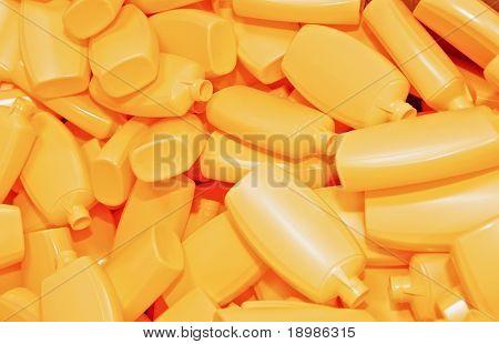 Heap gelben Plastikflaschen für Kosmetik