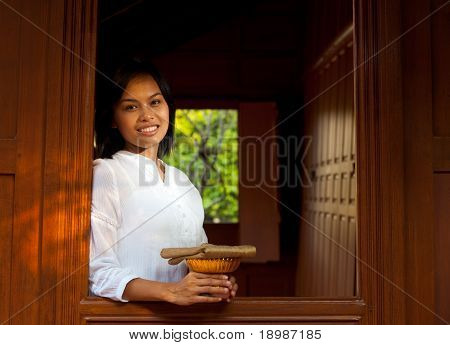 Pretty Lady Leaning Out Thai Teak House