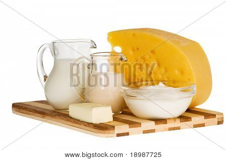 Group of dairy milk products ingredients on wood board isolated on white