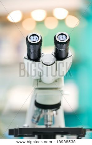 Closeup eyepiece of microscope. shallow depth of view