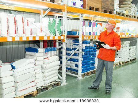 worker with cardboard at warehouse goods depot