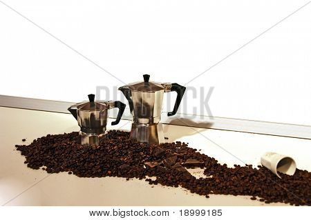 Coffee cup with coffee beans on the table