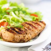 stock photo of brest  - Grilled chicken fillet with fresh vegetable salad - JPG