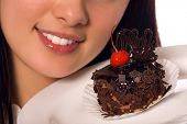 stock photo of gourmet food  - young girl with chocolate cake  - JPG