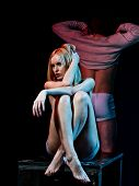 Sexy Girl And Undressing Young Man On Dark Background poster