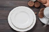 Empty Plates And Cup On Wooden Table poster