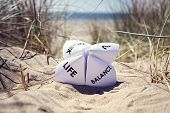 Origami fortune teller on vacation at the beach concept for work life balance choices poster