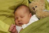 foto of newborn baby girl  - dreaming newborn baby  - JPG