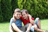 stock photo of snickers  - Portrait of two boys - JPG