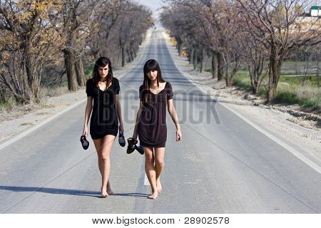 TA couple of young models parading in the middle of the road
