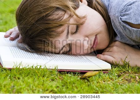 Young blonde taking a nap after reading