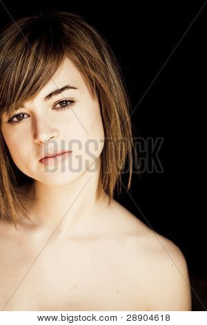 Beautiful woman portrait in black background